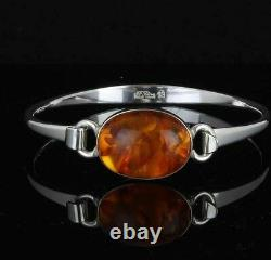 Danish silver bangle designed and made by N. E. From and set with Amber