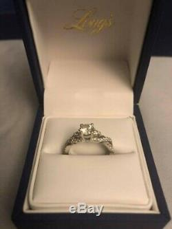 Long's custom made 3 stone engagement ring. With GIA Certification