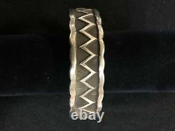 Navajo handcrafted sterling silver bracelet made in New Mexico, USA. By E. #788